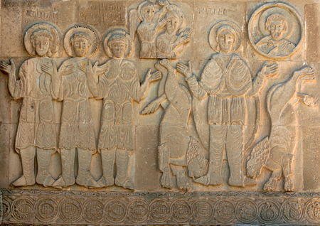 stone carving: A stone carving on the exterior wall of the magnificent Akdamar Killisesi (Church of the Holy Cross). Stock Photo