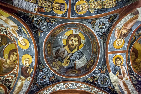 pantocrator: A beautiful fresco showing Christ Pantocrator at the Karanlik Kilise (Dark Church) at the Open Air Museum at Goreme in Cappadocia in Turkey. The frescos date from the late 12th century to the early 13th century. Editorial