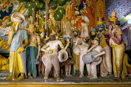 A colourful display including musicians and drummers in the main Image House at Wewurukannala Vihara near Dickwella on the south coast of Sri Lanka.