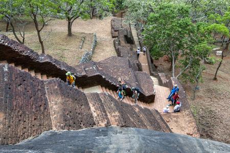 sigiriya: Visitors climb the ancient brick stairway which leads up to the Lion Platform at Sigiriya Rock Fortress in Sigiriya, Sri Lanka. Editorial