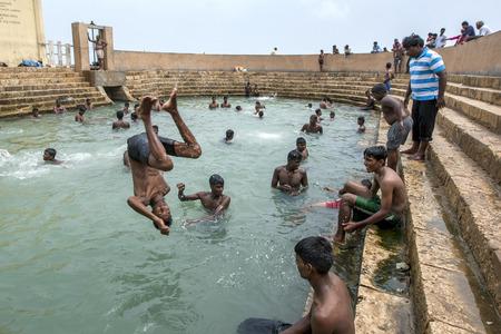 allegedly: Tamil bathers enjoy a swin in Vali North Pradeshiya Sabha (Keerimalai Sacred Bath)  in the northern Sri Lankan region of Jaffna. Keerimalai  was made famous after a 7th century Chola princess was allegedly cured after bathing in the waters of the pool. Editorial