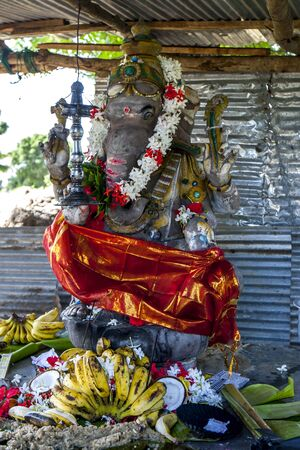 the east coast: A roadside Hindu Temple displaying the elephant god Ganesh set up on Pongal day in January near Pottuvil on the east coast of Sri Lanka.