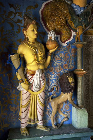 sri lanka temple: A statue and lion within one of the smaller temples within the Temple of the Sacred Tooth Relic in Kandy, Sri Lanka.