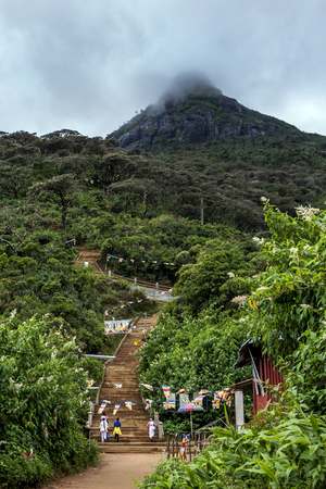 pada: Pilgrims head up the stairway towards the  2,243 metre (7,359 ft) high summit of Adams Peak (Sri Pada) in Sri Lanka. The 7km walk to the summit requires the navigation of 5200 steps. Editorial