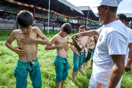 wrestlers: Young wrestlers have olive oil poured onto their bodies prior to competition beginning at the Kirkpinar Turkish Oil Wrestling Festival in Edirne in Turkey.