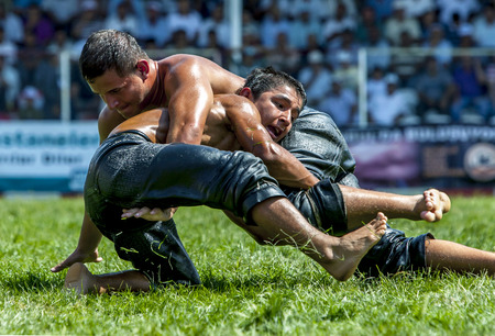 wrestlers: Wrestlers engaged in a close battle during competition at the Elmali Turkish Oil Wrestling Festival in Elmali in Turkey. Editorial