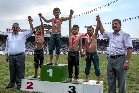 wrestlers: Champion young wrestlers are awarded their medals during a presentation ceremony at the Elmali Turkish Oil Wrestling Festival in Elmali in Turkey.