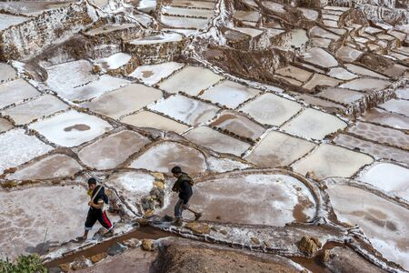 evaporation: A section of the spectacular Maras salt evaporation ponds. Located in the Sacred Valley of the Incas region of Peru, some 40 kilometres north of Cusco, the ponds have been in use since the days of the Incas.