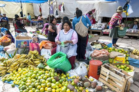 sacred valley of the incas: A colourful display of fruit and vegetable sellers at the market in Pisac located in the Sacred Valley of the Incas in Peru. Editorial