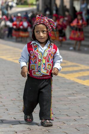 plaza de armas: A colourfully dressed Peruvian boy dances at the Plaza de Armas in Cusco in Peru during May Day celebrations.