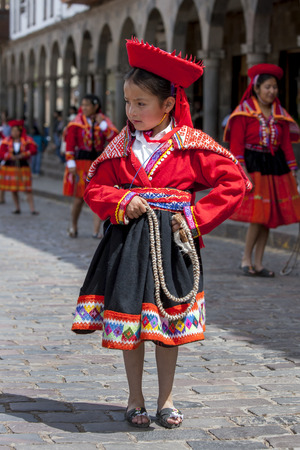 colourfully: A colourfully dressed Peruvian girl dances at the Plaza de Armas in Cusco in Peru during May Day celebrations. Editorial