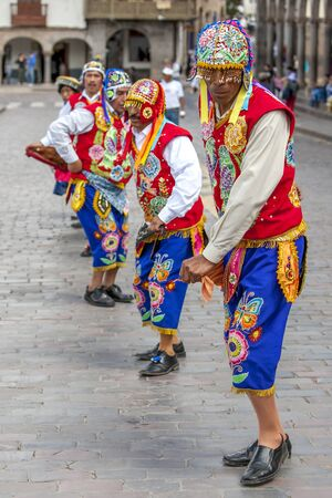 plaza de armas: Colourfully dressed Peruvian men dance at the Plaza de Armas in Cusco in Peru during May Day celebrations.