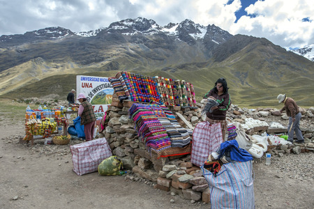 metres: A souvenir and textile stall set up at La Region Puno Les Desea Feliz Viaje. At a height of 4335 metres, this market lies on the mountain road from Cusco to Puno