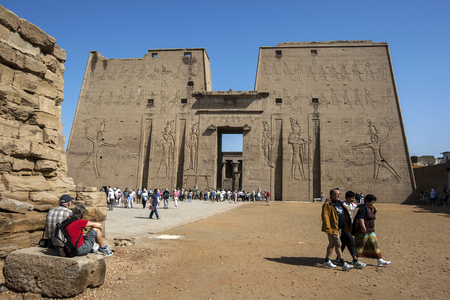 metres: The pylon at the Temple of Horus at Edfu in Upper Egypt. Standing 36 metres high, the pylons walls are engraved with reliefs depicting Ptolemy XII Neos Dionysos holding  his enemies by the hair as Horus smashes their skulls. Editorial