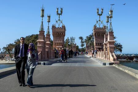 the royal park: A couple walk near the beautifully designed bridge of Montazah Palace in Royal Park in Alexandria, Egypt.