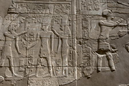 engravings: Hieroglyphs and relief engravings carved into a wall at Karnak Temple (Temple of Amun) in Luxor, Egypt. Stock Photo