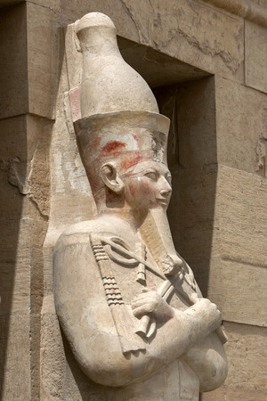 mortuary: One of the Osirid pillars which stands along the upper terrace at the Mortuary Temple of Hatshepsut at Deir al-Bahri near Luxor in central Egypt. Stock Photo