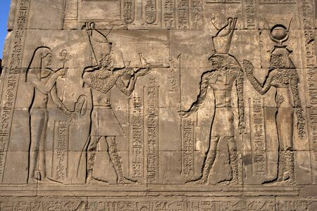 horus: A wall at the Temple of Horus in Edfu showing engraved reliefs and hieroglyphs.