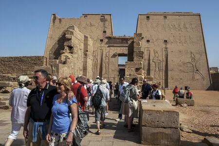 metre: Tourists crowd into the Temple of Horus in Edfu, Egypt. In the background stands the giant 36 metre high pylon entrance into the temple. Editorial