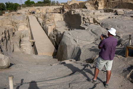 A tourist takes a photograph of the Unfinished Obelisk at the ancient Western Quarry near Aswan in Egypt. The obelisk was being constructed for the Pharaoh Seti I (1294- 1279 BC) and was carved on three sides before a crack was discovered in the rock.