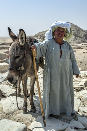 necropolis: An Egyptian man and his donkey pose for photos at the Saqqara Necropolis near the Step Pyramid. Saqqara is located 17km from the Cairo suburb of Giza. Editorial