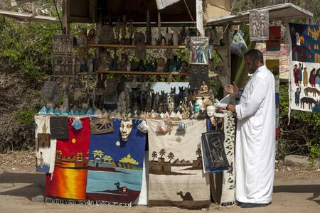 seller: A souvenir seller stands next to his stall at the ancient Egyptian capital of Memphis in northern Egypt. Editorial