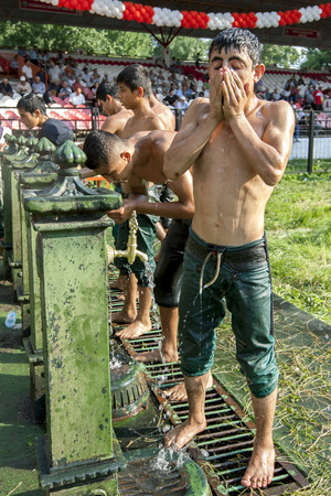 edirne: A wrestler cools down at the water fountains within the arena after competing at the Kirkpinar Turkish Oil Wrestling Festival in Edirne in Turkey. Kirkpinar is the most famous oil wrestling tournament in Turkey.