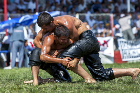 wrestlers: Middle weight wrestlers engage in battle at the Elmali Turkish Oil Wrestling Festival in Elmali in Turkey.