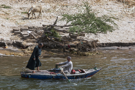 the nile: Men rowing down the River Nile near Luxor in Egypt. Editorial