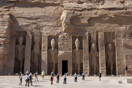 abu simbel: The ruins of  the Temple of Hathor, which was dedicated by Ramses II to his most beloved wife Nefertari at Abu Simbel in Egypt. Built on the west bank of the River Nile between 1274 and 1244 BC, it   was swallowd up by the moving desert sands and remained Editorial