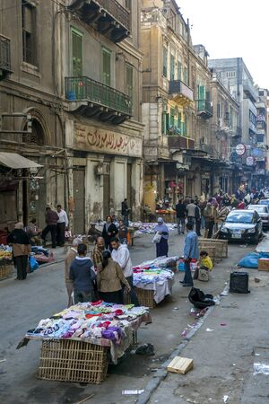 traders: Traders with their textile stalls set up in a backstreet of Alexandria in Egypt.