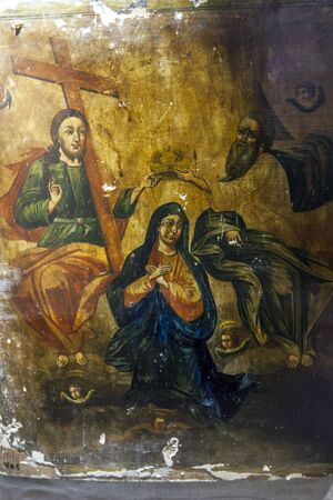 17th: A painting showing the Virgin Mary surrounded by angels as two saints place a crown on her head. Dating from the 17th or 18th Century it is on display at the Alexandria Museum in Egypt.