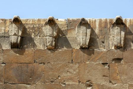 necropolis: Cobra figures adorn the eastern wall of the Saqqara Necropolis at Saqqara near Cairo in Egypt.