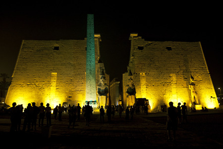 obelisk: The entrance pylon of the Luxor Temple (Temple of Amun-Ra) in Luxor, Egypt. The entrance is highlighted by the obelisk and two giant statues of Ramesses ll.