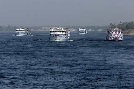 fleet: A fleet of floating hotels motor down the River Nile towards Luxor in Egypt.