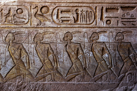 slaves: An engraving depicting bound slaves on the wall leading into the Great Temple of Ramesses II at Abu Simbel in Egypt.