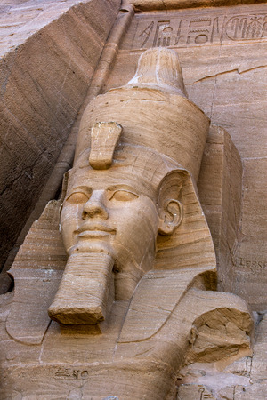 abu simbel: One of the statues of Ramesses II at the magnificent ruins of the Great Temple of Ramesses II at Abu Simbel in Egypt.