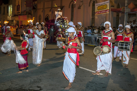 cymbal: Cymbal Players and various drummers perform in front of large crowds in Kandy during the Esala Perahera. The Esala Perahera is held to honour the Sacred Tooth Relic of Lord Buddha.