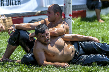 wrestlers: Wrestlers relax after competing at the Elmali Turkish Oil Wrestling Festival in elmali in Turkey.