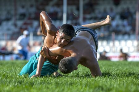 wrestlers: Young wrestlers battle for victory at the Elmali Turkish Oil Wrestling Festival in Elmali in Turkey.