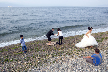 newly married couple: A newly married couple leave the beach at Mudanya in Turkey after a late afternoon photo session. Editorial
