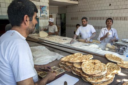 turkish bread: Men busy at work making Turkish flat bread in a bakery in Urfa (Sanliurfa) in south eastern Turkey.