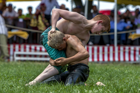 wrestlers: Young wrestlers battle for victory at the Velimese Turkish Oil Wrestling Festival in Turkey. Editorial