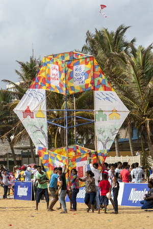 hundreds: An enormous kite is prepared for take off above Negombo beach in Sri Lanka. It was one of hundreds of kites which took to the sky during the annual kite festival.