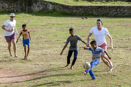 galle: Sri Lankan boys play football with foreign men inside the old Dutch Fort at Galle in Sri Lanka. Football is a favourite game to play in Sri Lanka.