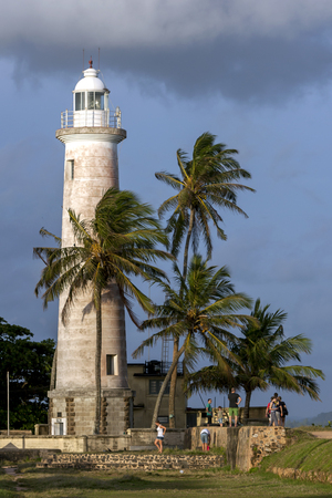 metre: Tourists gather at the base of the lighthouse at Point Utrecht Bastion which is situated on the eastern section of the old Dutch Fort in Galle in Sri Lanka. The 18 metre high lighthouse was built in 1938.