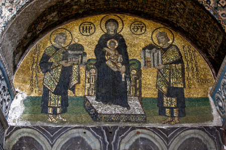 justinian: South-western entrance mosaic of the former basilica Hagia Sophia of Constantinople in Istanbul in Turkey). The Virgin Mary is standing in the middle, holding the Child Christ on her lap. On her right side stands emperor Justinian I, offering a model of t