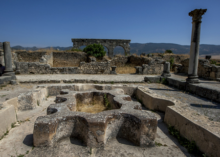 3rd ancient: The interior of the North Baths, fed by the aqueduct at Volubilis in Morocco. Volubilis is a former Berber and Roman city in Morocco settled in the 3rd century BC. It is situated near the modern city of Meknes and was the ancient capital of the kingdom of Stock Photo