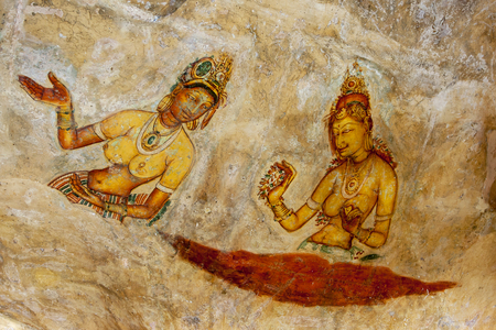 nymphs: One of the beautiful frescoes at Sigiriya Rock in Sigiriya, Sri Lanka. Dating from around the 5th century, there is debate over whether the figures depict King Kassapas concubines, apsaras (celestial Nymphs) or the Mahayana goddess, Tara.