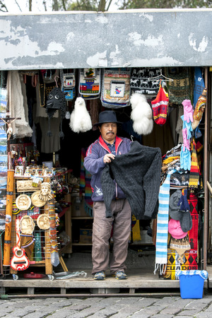 metre: A man sets up his souviner stall at El Panecillo, a 200 metre high volcanic hill overlooking Quito in Ecudor. He sells his textiles and crafted goods to the tourist market. Editorial
